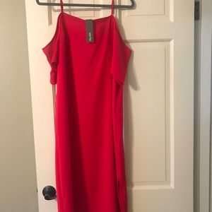 Red dress- ankle length with side slit.